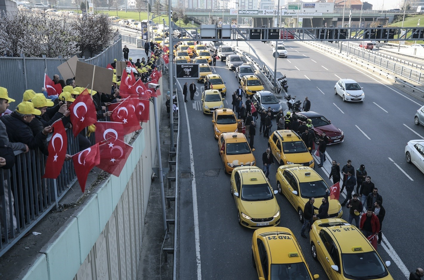 Taxi drivers stage a rally outside an Istanbul courthouse prior to a hearing of a trial against Uber in March.