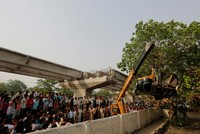 18 killed after highway overpass collapses over crowd in India