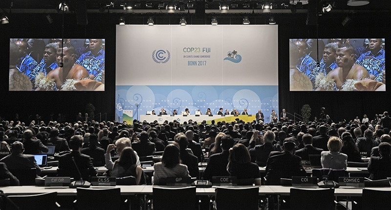 In this Monday, Nov. 6, 2017 file photo, Native people from Fiji sit in the convention center during the opening of the COP 23 Fiji UN Climate Change Conference in Bonn, Germany. (AP Photo)