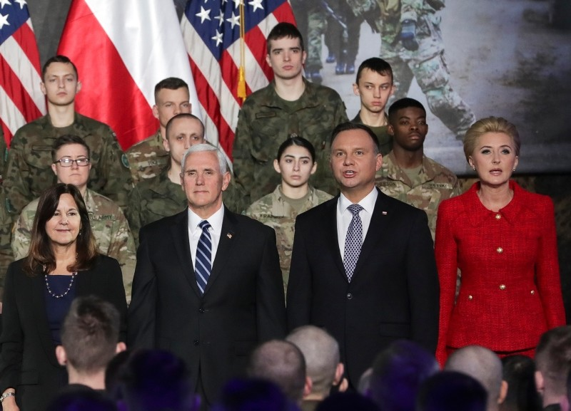 United States Vice President Mike Pence, (2L) and his wife Karen Pence (L) stand together with Poland's President Andrzej Duda, (2R) and his wife Agata Kornhauser-Duda in front of soldiers in Warsaw, Poland, Wednesday, Feb. 13, 2019. (AP Photo)