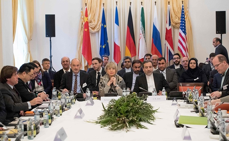 Abbas Araghchi, political deputy at the Ministry of Foreign Affairs of Iran, and the Secretary General of the EU External Action Service Helga Schmid along with delegates attend E3/EU+3, Iran talks in Vienna on March 16, 2018. (AFP Photo)