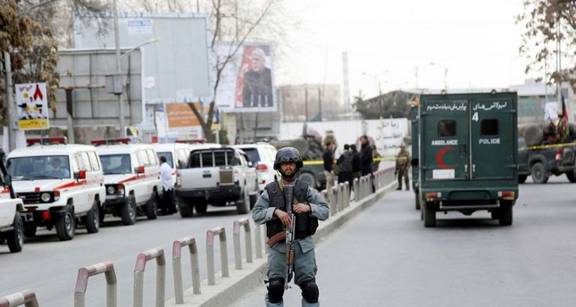 An armed Afghan security official secures the surroundings of the Sardar Daud Khan's Hospital, also known as Kabul Military Hospital.  (EPA Photo)