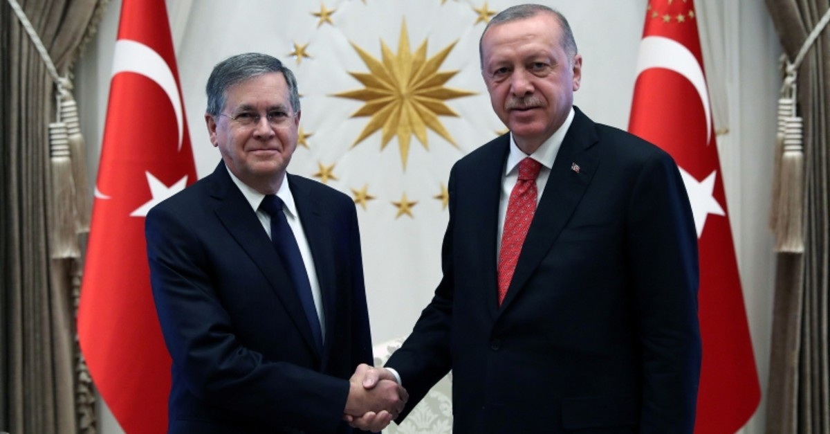 President Recep Tayyip Erdou011fan shakes hands with US Ambassador David M. Satterfield during a ceremony to receive credentials from newly envoys at the Presidential Complex in Ankara, Turkey, Aug. 28, 2019. (Cem u00d6ksu00fcz/Presidential Press Office/Handout)