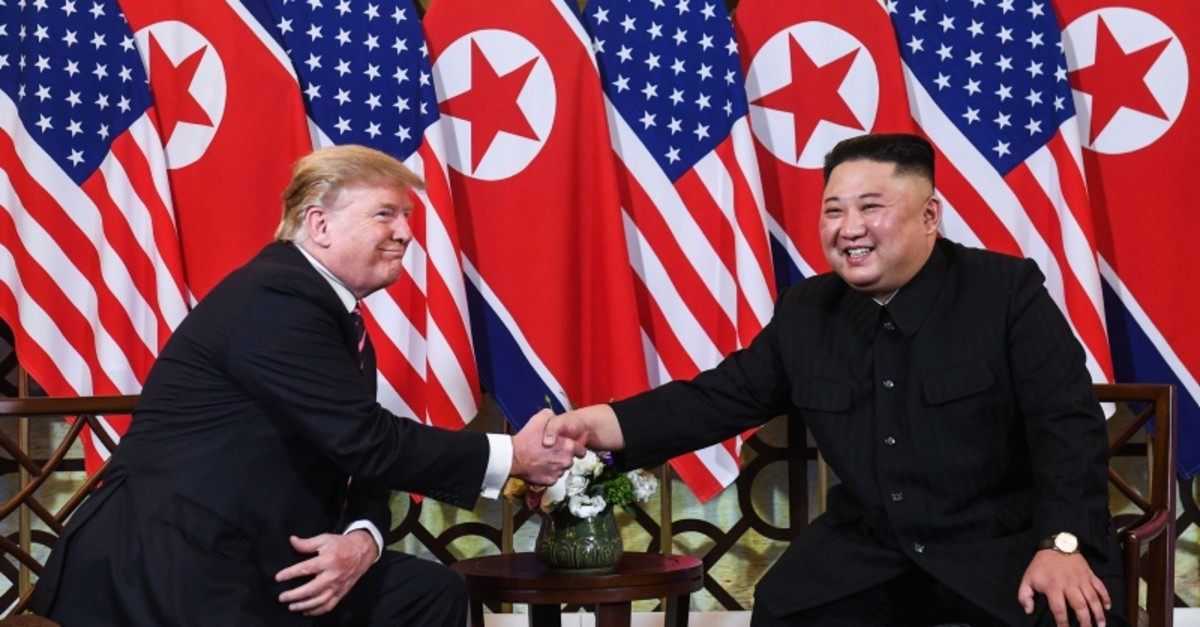 US President Donald Trump (L) shakes hands with North Korea's leader Kim Jong Un following a meeting at the Sofitel Legend Metropole hotel in Hanoi on February 27, 2019. (AFP Photo)