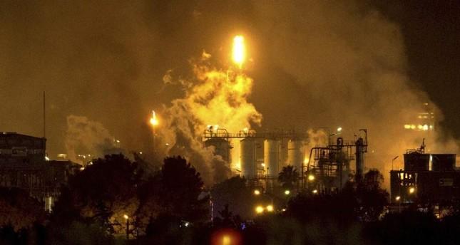 Smoke rise following a big explosion at an industrial hub near the port city of Tarragona, Spain, Tuesday, Jan. 14, 2020. AP Photo