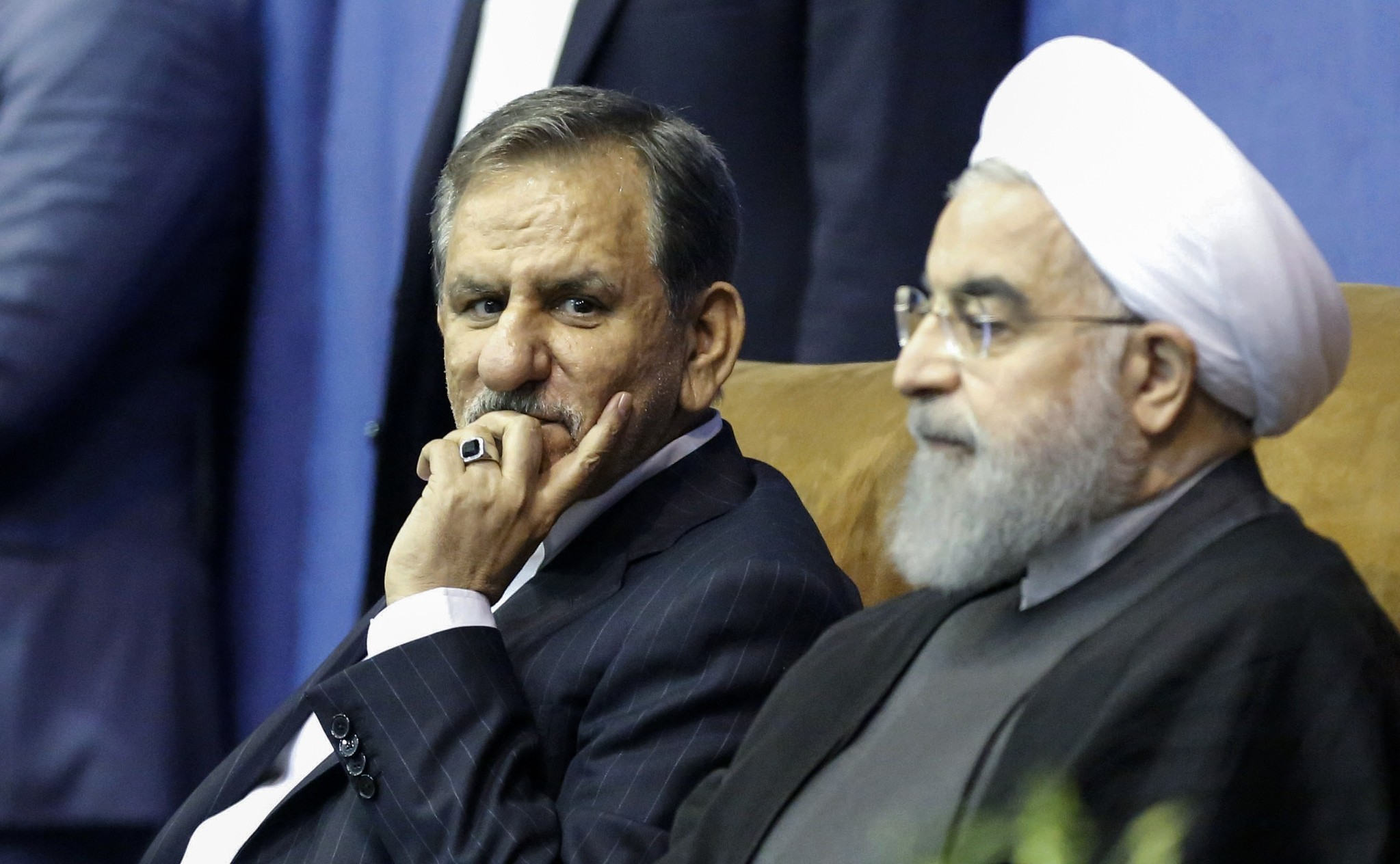Iranian President and presidential candidate Hassan Rouhani (R), along with current vice-president and presidential candidate Eshaq Jahangiri. (AFP PHOTO )