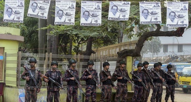 Members of Border Guard Bangladesh (BGB) stand guard in a street for the upcoming election in Dhaka on December 26, 2018. (AFP Photo)