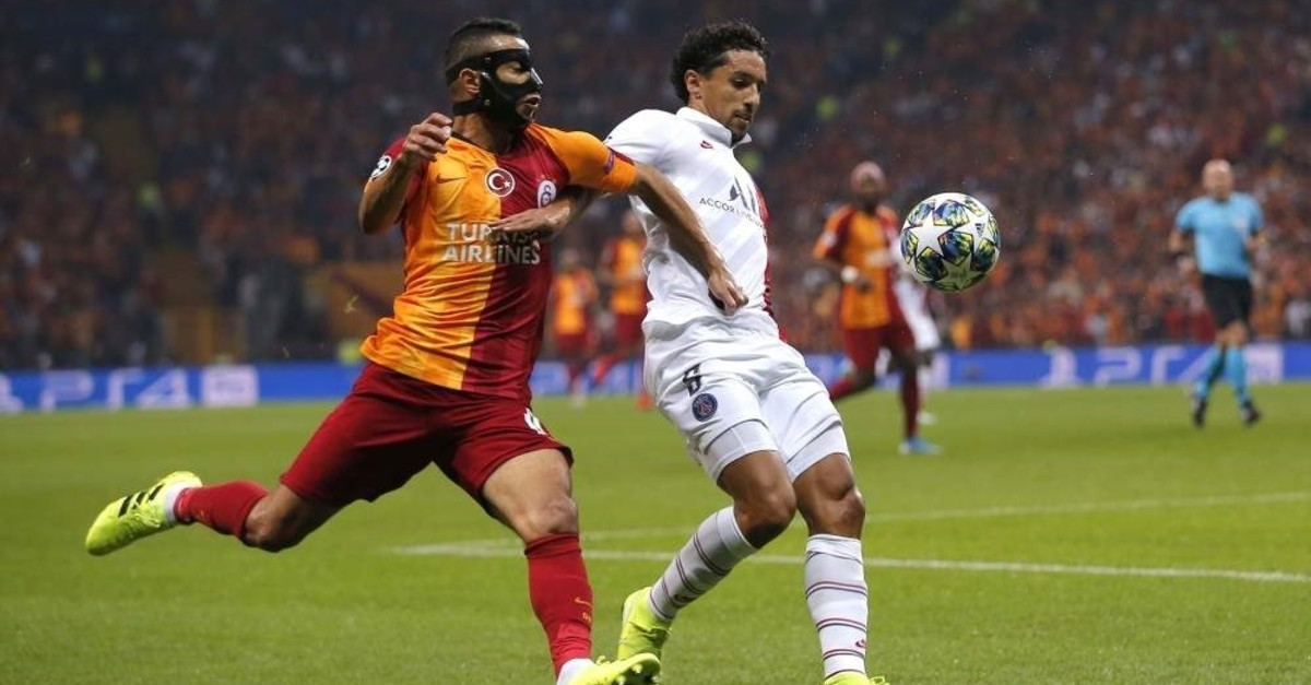 Galatasaray's Younes Belhanda (left) and PSG's Marquinhos vie for the ball during their Champions League match, Istanbul, Oct. 1, 2019. (AP Photo)