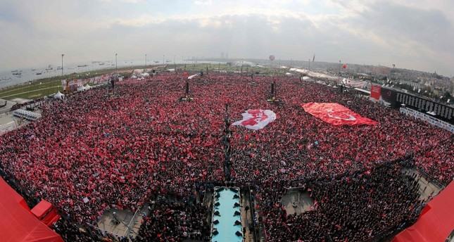 Turkish people waving the national flag and 'yes' banners as President Erdoğan delivers a speech during a rally for the constitutional referendum at the Yenikapı Square in Istanbul, April 8.