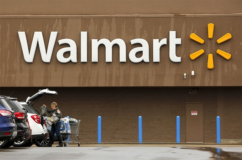 In this Feb. 22, 2018, file photo, a shopper loads her car after shopping at a Walmart in Pittsburgh. (AP Photo)