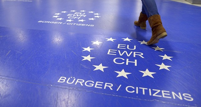 A picture made available on 05 May 2014 shows a woman walking up to the passport control point for citizens of the European Union at Duesseldorf Airport which uses the new automatic easy-pass control system. (EPA Photo)
