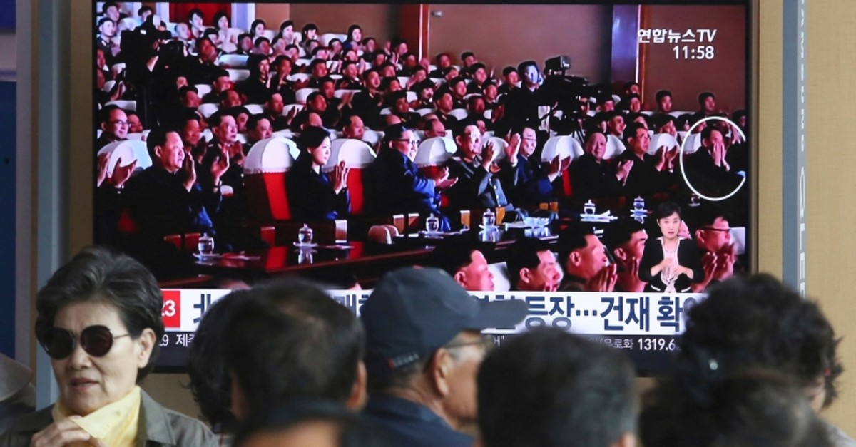 TV screen showing an image of North Korean leader Kim Jong Un and senior official Kim Yong Chol, in a musical performance in North Korea during a news program at the Seoul Railway Station in Seoul, South Korea, Monday, June 3, 2019. (AP Photo)