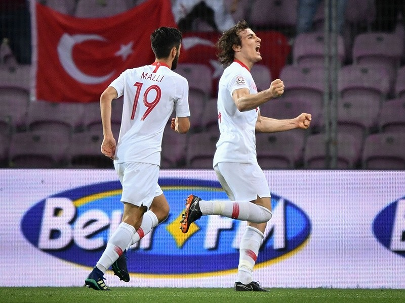 Turkey's defender u00c7au011flar Su00f6yu00fcncu00fc (R) celebrates after scoring his team's second goal during the friendly football match between Tunisia and Turkey at the Stade de Geneve stadium in Geneva on June 1, 2018. (AFP Photo)