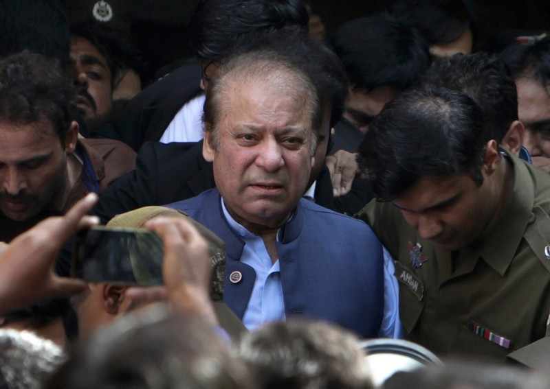 In this Oct. 8, 2018 file photo, former Pakistan Prime Minister Nawaz Sharif leaves after appearing in a court in Lahore, Pakistan. (AP Photo)