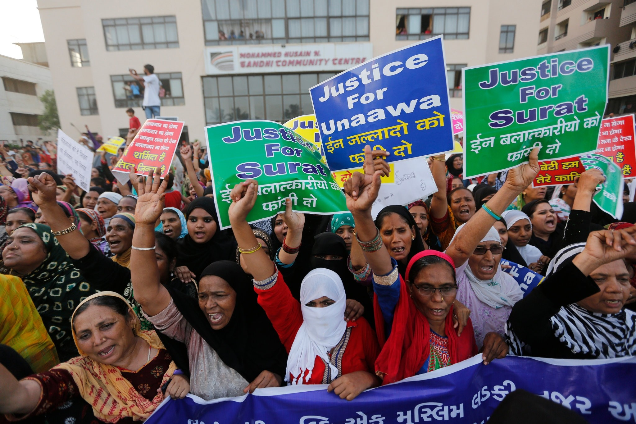 Indian women shout slogans as they participate in a rally to protest against recent incidents of rape, in Ahmadabad, India, Wednesday, April 18, 2018. (AP Photo)