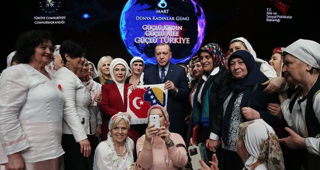 First Lady and President Erdoğan poses with women on the sidelines of the event held at the Presidential Complex.