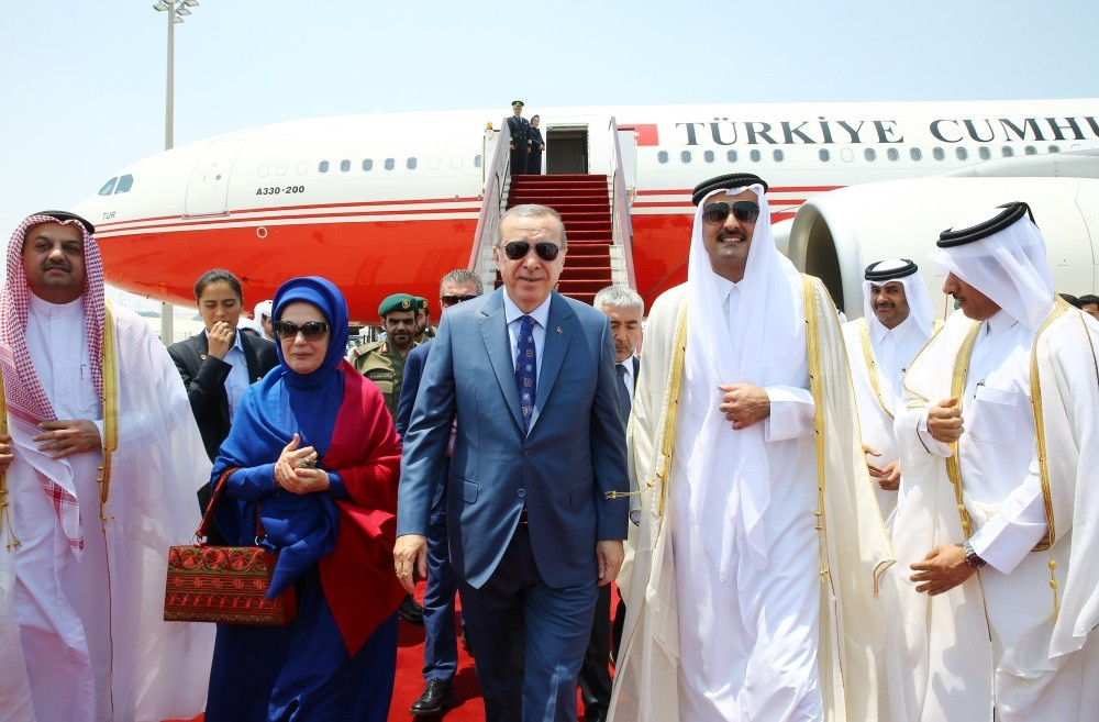 President Erdou011fan (middle) and his wife Emine Erdou011fan (L) greeted by Qatar Emir Sheikh Tamim bin Hamad al-Thani (R) upon their arrival in the Qatari capital of Doha as a part of President Erdou011fan's Gulf tour yesterday.