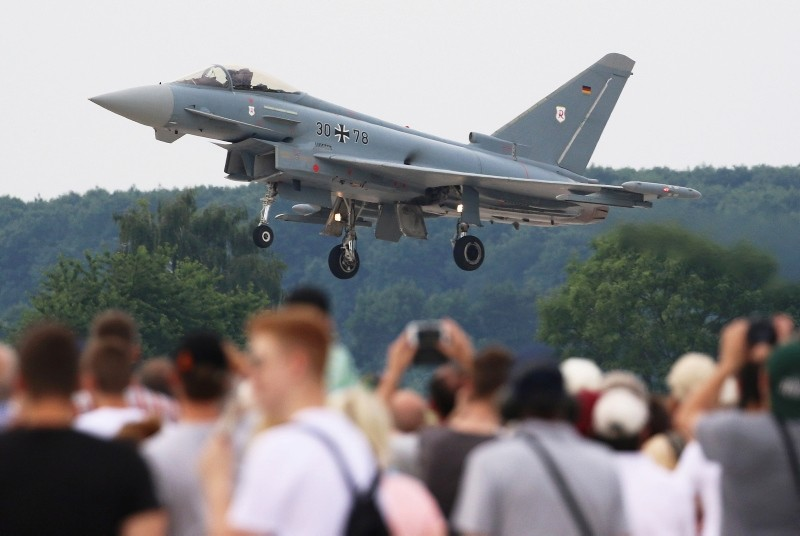 Spectators look on landing Eurofighter Typhoon aircraft of the German Air Forceduring the 'Day of the German Forces' at the air force base in Wunstorf, northern Germany, June 9, 2018. (EPA Photo)
