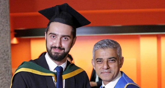 Tirej Brimo poses with London Mayor Sadiq Khan at his graduation ceremony St George's, University of London.