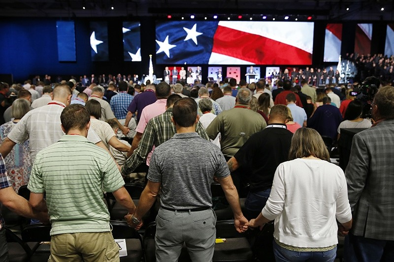 In this Tuesday, June 12, 2018 file photo, people pray for America at the 2018 Annual Meeting of the Southern Baptist Convention at the Kay Bailey Hutchison Dallas Convention Center in Dallas. (AP Photo)