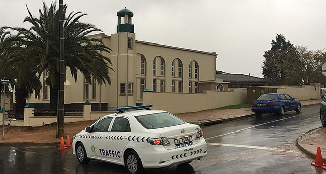 In this picture taken with a phone a South African police vehicle is parked outside the Malmesbury main mosque following a stabbing attack that left two worshippers dead on June 14, 2018 in Malmesbury, north of Cape Town. (AFP Photo)