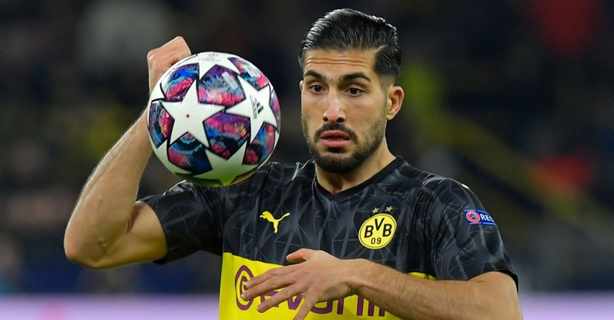 Dortmund's Emre Can holds the ball during the Champions League round of 16 first leg soccer match between Borussia Dortmund and Paris Saint Germain in Dortmund, Germany, Tuesday, Feb. 18, 2020. (AFP Photo)