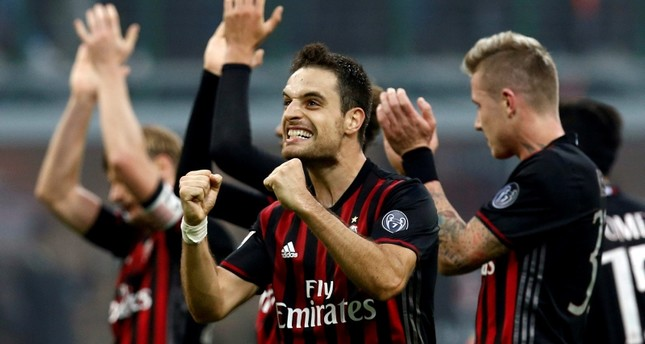 AC Milan's Giacomo Bonaventura celebrates their win at the end of the match. (Reuters Photo)