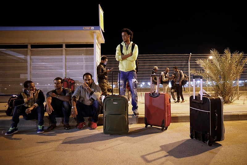 African migrants wait for a bus after being released from Saharonim Prison in the Negev desert, Israel April 4, 2018. (Reuters Photo)