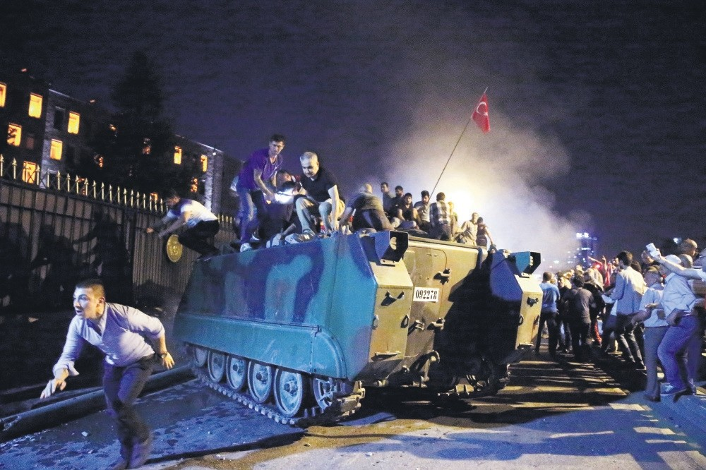 An anti-coup crowd surround and capture a tank hijacked by putschists outside the main military headquarters in Ankara. Putschists had captured several strategic locations in the capital, including the Tu00fcrk Telekom building, on July 15, 2016.