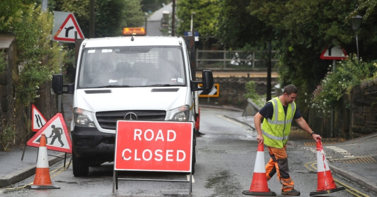 A roadblock is put in place at Whaley Lane the entrance to the village of Whaley Bridge, Cheshire, England, Thursday, Aug. 1, 2019 (AP Photo)