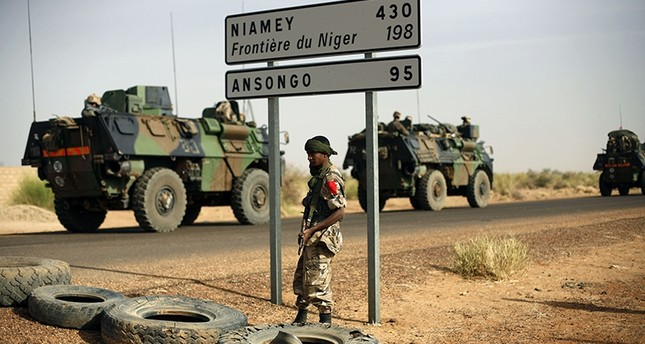 This Feb. 6, 2013, file photo shows French armoured vehicles heading towards the Niger border before making a left turn north in Gao, northern Mali. (AP Photo)