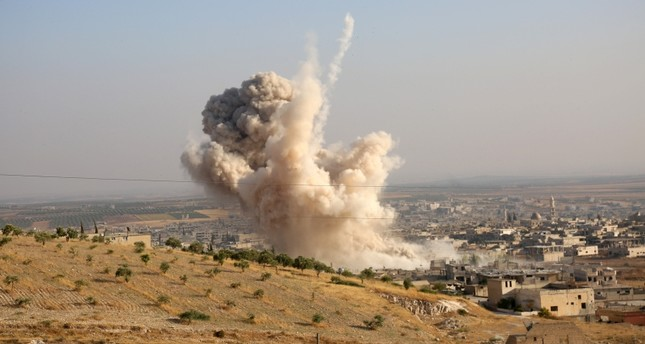 Smoke rises from the town of Khan Sheikhoun in Syria's northwestern Idlib province after an Assad regime strike, on Aug. 14, 2019. AA Photo