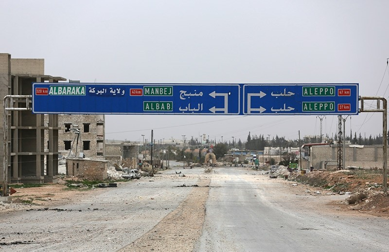 A road sign that shows the direction to Manbij city is seen in the northern Syrian town of al-Bab, Syria March 1, 2017. Picture taken March 1, 2017. (Reuters Photo)