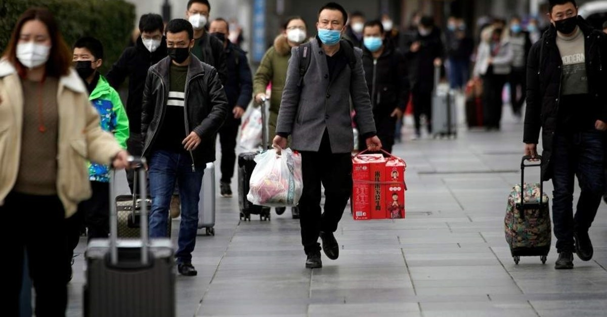 Passengers wearing masks walk outside the Shanghai railway station in Shanghai, China, as the country is hit by an outbreak of a new coronavirus, Feb. 2, 2020. (Reuters Photo)