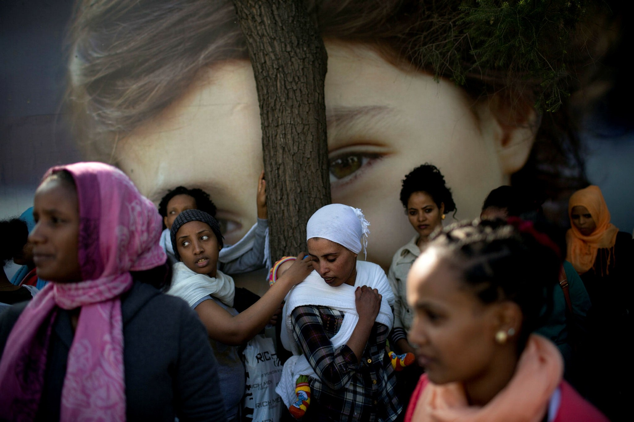 In this  Jan. 15, 2014, file photo, African female and child migrants protest in front of the UNHCR office demanding asylum and work rights from the Israeli government in Tel Aviv, Israel. (AP Photo)