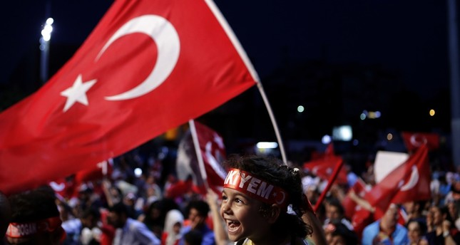 A child siting on the shoulders of an adult during an anti-coup rally at Taksim Square in central Istanbul, July 31.