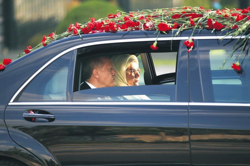 President Erdou011fan (L) and his wife Emine Erdou011fan arriving at the Presidential Complex, Ankara, July 9.