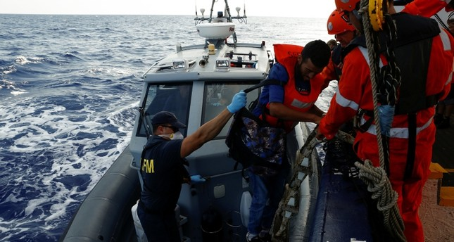 A Tunisian migrant is helped onto an Armed Forces of Malta boat to be medically evacuated from the German NGO Sea-Eye migrant rescue ship 'Alan Kurdi' in international waters off Malta in the central Mediterranean Sea, Sept. 6, 2019. (Reuters Photo)