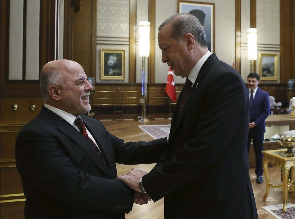 President Recep Tayyip Erdou011fan greets Iraqi Prime Minister Haider al-Abadi before a meeting at the Beu015ftepe Presidential Complex in Ankara, October 2017.