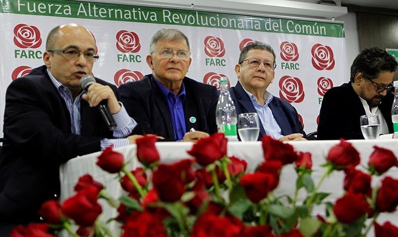 Members of the political party FARC look on during the presentation of their candidates in Bogota, Colombia November 1, 2017. (Reuters Photo)