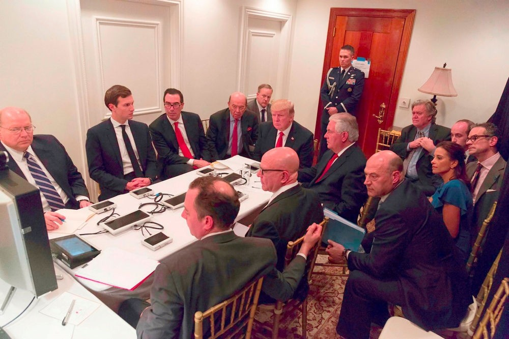 U.S. President Donald Trump receiving a briefing with his closest advisors on the Syria military strike from the National Security team via secure video teleconference on April. (AP Photo)