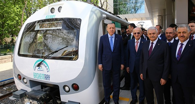 (Counterclockwise) President Recep Tayyip Erdoğan, Parliament Speaker Ismail Kahraman, PM Binali Yıldırım and Transport Minister Ahmet Arslan pose for a photo before the maiden journey of a suburban line train in Ankara, April 12, 2018. (AA Photo)