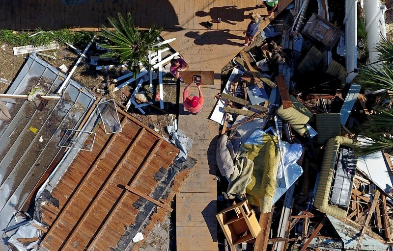 The Wood family begins cleanup efforts among the debris of their damaged home from hurricane Michael in Mexico Beach, Fla., Sunday, Oct. 14, 2018. (AP Photo)