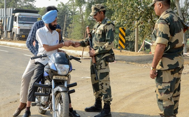 Border Security Force (BSF) personnel check identity documents of motorcyclists at Dera Baba Nanak, 50 kilometers from Amritsar, India, Oct. 24, 2019. (AFP Photo)