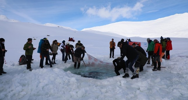 A fun act of bravery, swimmers dive into glacial lake in Turkey's Rize