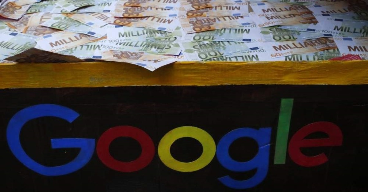 A trunk full of fake bank notes is displayed as activists from anti-globalization organization Attac stage a protest at Google's Paris headquarters to criticize the company's tax evasion policies, in Paris, Jan. 31, 2019. (AP Photo)