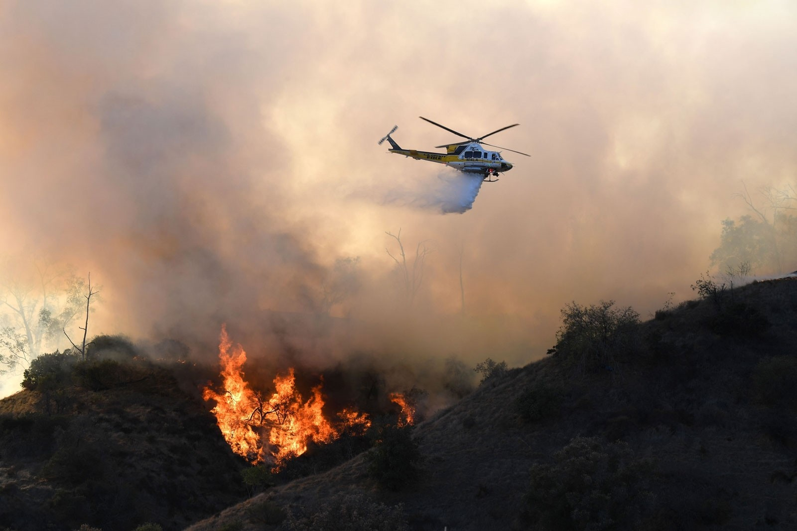 Two monster wildfires burn out of control  in northern and southern California