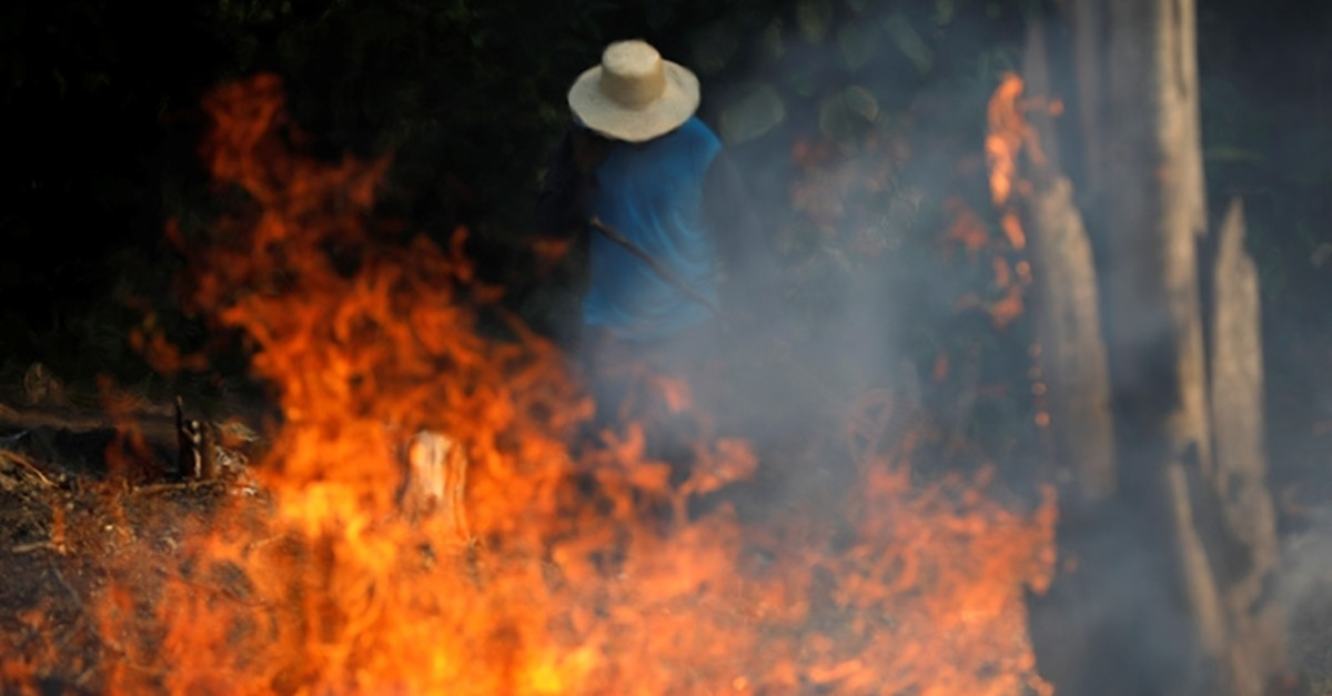 A man works in a burning tract of Amazon jungle as it is being cleared by loggers and farmers in Iranduba, Amazonas state, Brazil Aug. 20, 2019 (Reuters Photo)
