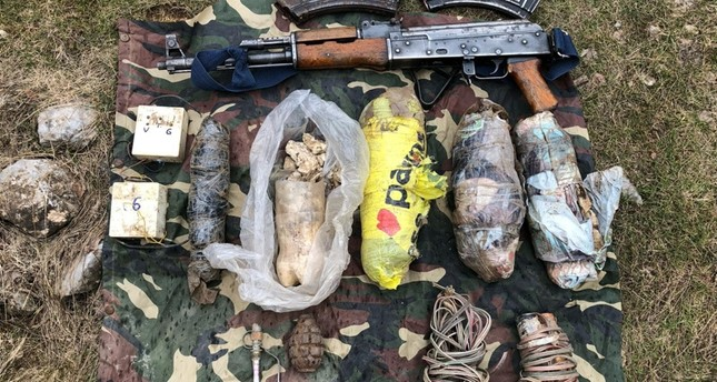Weapons and ammunition seized from PKK shelters during anti-terror operation in Hakkari on Wednesday, March 13, 2019. AA Photo