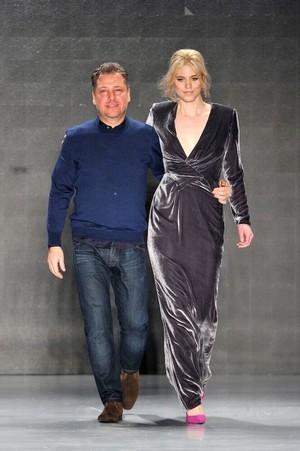 Atıl Kutoğlu with top model Larissa Marolt after a show.